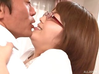 Brunette Japanese MILF with glasses gets cum on the brush tits after a fuck
