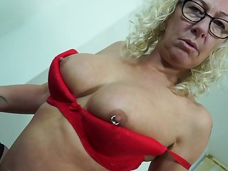 Chesty mature blonde MILF with pierced tits Chanele masturbates
