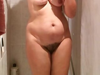 Beautiful woman with correct boobs and gradual pussy taking a long shower.